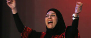 Palestinian primary school teacher Hanan al-Hroub reacts after she won the second annual Global Teacher Prize, in Dubai, United Arab Emirates, Sunday, March 13, 2016. Al-Hroub who encourages students to renounce violence won a $1 million prize for teaching excellence. (AP Photo/Kamran Jebreili)
